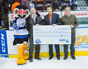 Ice Caps Cares Foundation representative, Trevor Murphy, presents a cheque of $6000 to Andy Butt (left) and Gerard Morris (right) of SPMHF